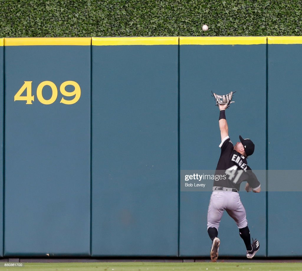 Adam Engel #41 of the Chicago White Sox attempts to make a catch on a line drive by Josh Reddick #22 of the Houston Astros in the seventh inning at Minute Maid Park on September 20, 2017 in Houston, Texas.
