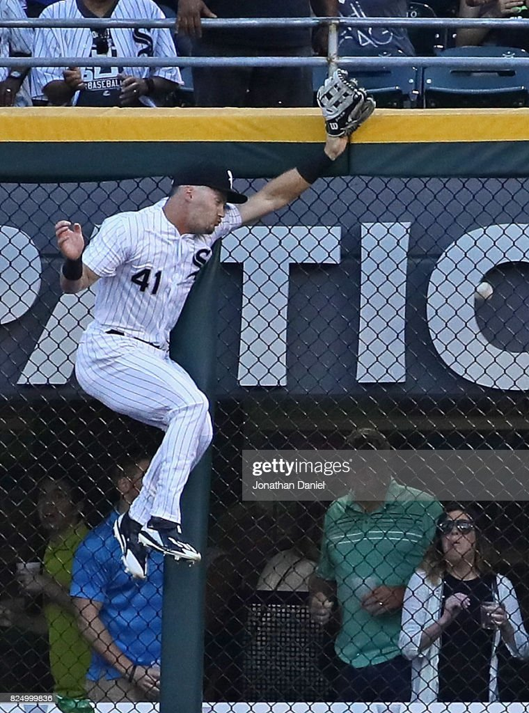 Adam Engel #41 of the Chicago White Sox hits the wall trying to reach a home run ball hit by Josh Donaldson of the Toronto Blue Jays in the 1st inning at Guaranteed Rate Field on July 31, 2017 in Chicago, Illinois.