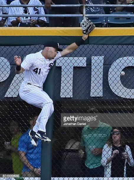 Adam Engel of the Chicago White Sox hits the wall trying to reach a home run ball hit by Josh Donaldson of the Toronto Blue Jays in the 1st inning at...