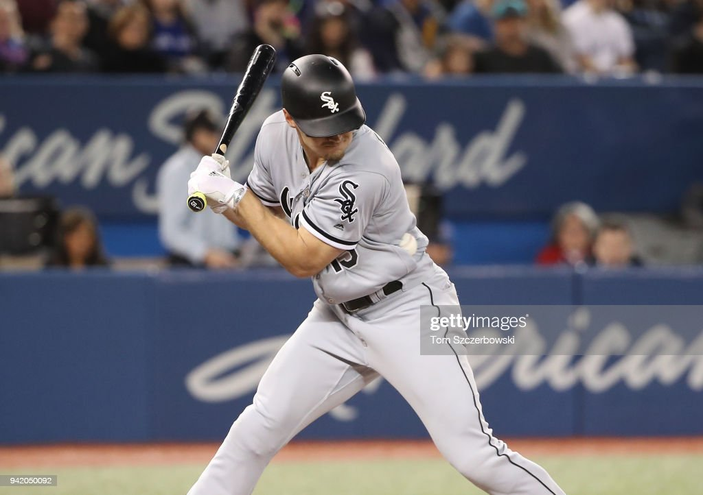Adam Engel #15 of the Chicago White Sox is hit by pitch in the fifth inning during MLB game action against the Toronto Blue Jays at Rogers Centre on April 4, 2018 in Toronto, Canada.