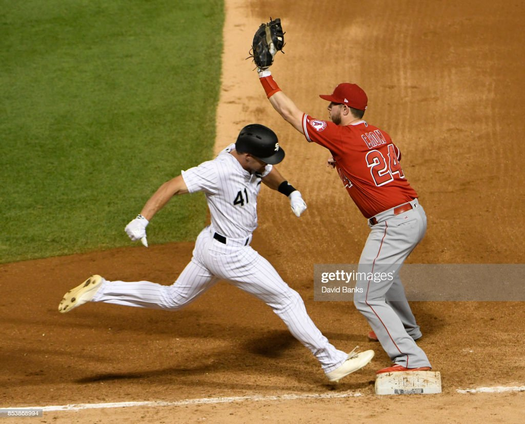 Adam Engel #41 of the Chicago White Sox is out at first base as C.J. Cron #24 of the Los Angeles Angels of Anaheim takes the throw during the fourth inning on September 25, 2017 at Guaranteed Rate Field in Chicago, Illinois.