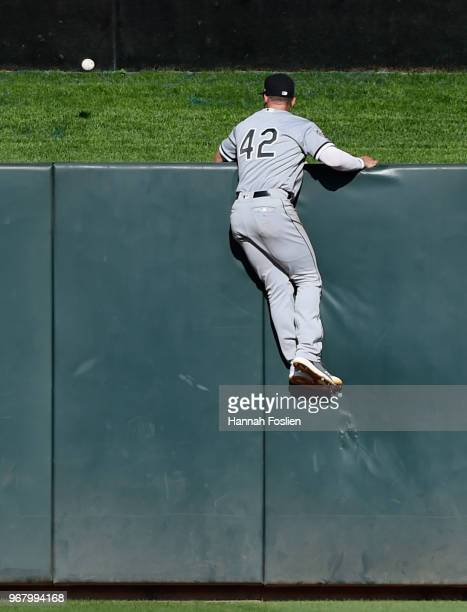 Adam Engel of the Chicago White Sox looks on as a threerun home run by Eduardo Escobar of the Minnesota Twins clears the center field fence during...