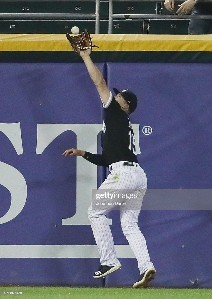 Adam Engel #15 of the Chicago White Sox makes the game-ending catch at the center field wall against the Cleveland Indians at Guaranteed Rate Field on June 12, 2018 in Chicago, Illinois. The White Sox defeated the Indians 5-1.