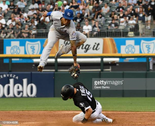 Adam Engel of the Chicago White Sox steals second base as Adalberto Mondesi of the Kansas City Royals makes a late tag during the third inning on...