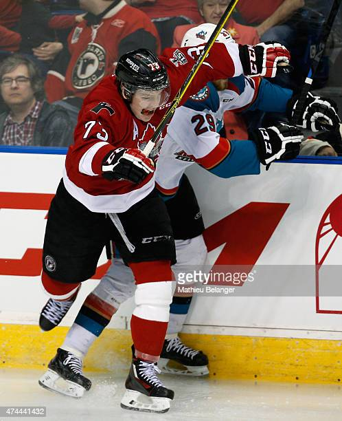 Adam Erne of the Quebec Remparts hits Leon Draisaitl of the Kelowna Rockets during Game One of the Memorial Cup at the Pepsi Coliseum on May 22 2015...