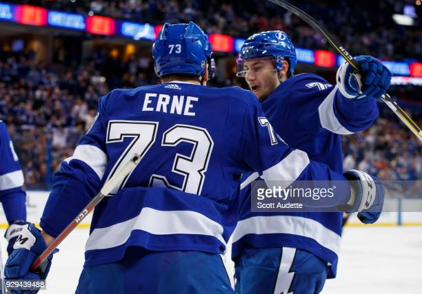 Adam Erne of the Tampa Bay Lightning celebrates a goal with teammate Anthony Cirelli against the New York Rangers during the first period at Amalie...