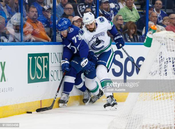 Adam Erne of the Tampa Bay Lightning skates against Erik Gudbranson of the Vancouver Canucks during the first period at Amalie Arena on February 8...