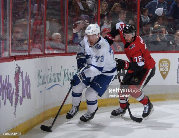 Adam Erne of the Tampa Bay Lightning stickhandles the puck away from Thomas Chabot of the Ottawa Senators at Canadian Tire Centre on April 1, 2019 in...