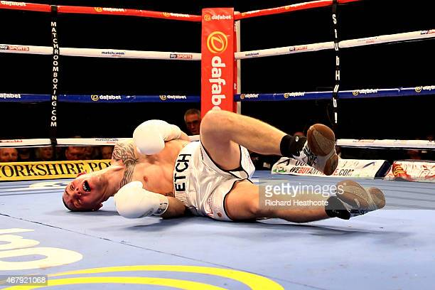 Adam Etches of Great Britain is knocked out by Sergei Khomitsky of Belarus during the IBF international middleweight championship fight at Motorpoint...