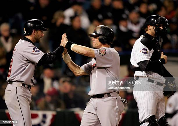 Adam Everett and Craig Biggio of the Houston Astros celebrate with teammates after scoring on a double by Lance Berkman against the Chicago White Sox...