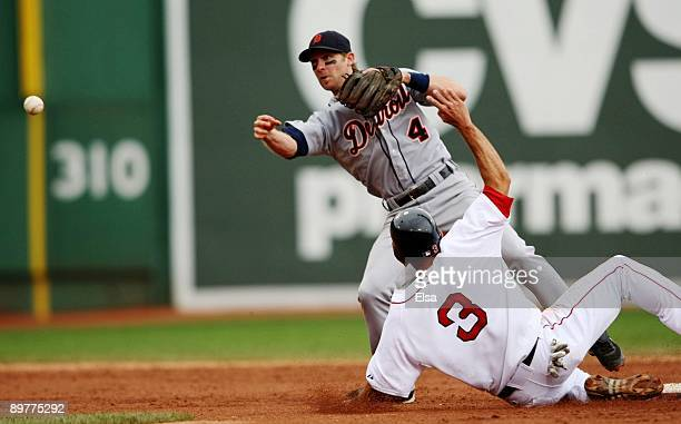 Adam Everett of the Detroit Tigers tries to make a double play tagging out Chris Woodward of the Boston Red Sox during the game at Fenway Park on...