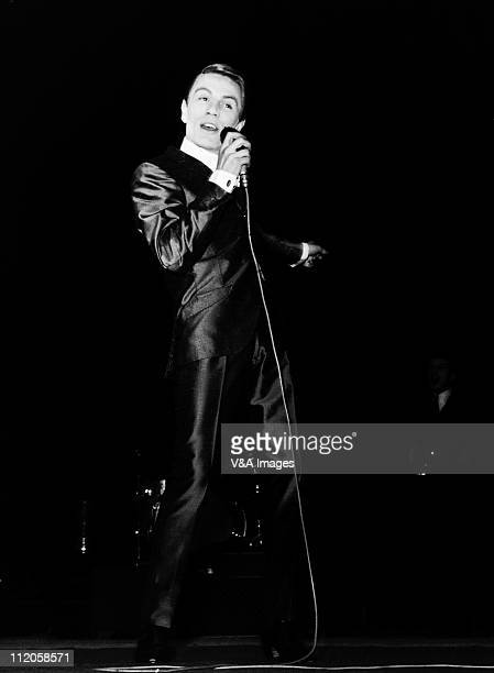 Adam Faith performs on stage 1960