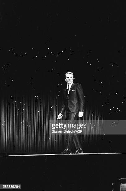 Adam Faith performs on stage at a variety performance London circa 1965