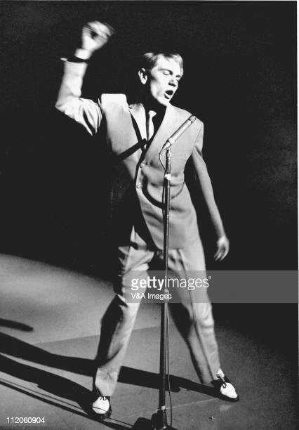 Adam Faith performs on stage full length 1960