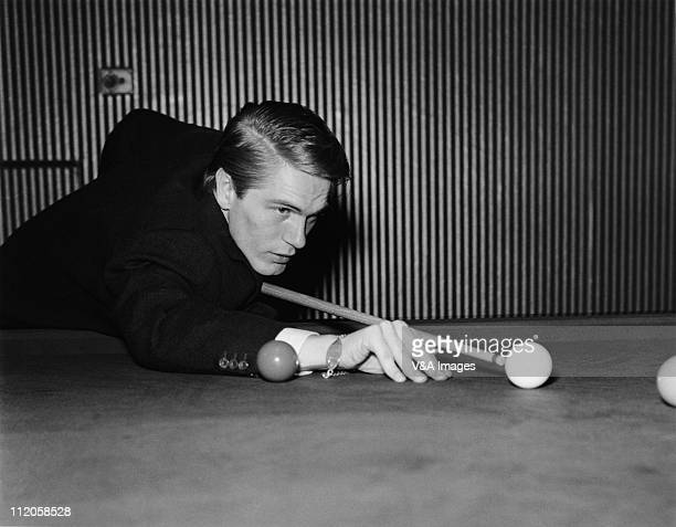 Adam Faith playing snooker at home in Esher Surrey 1960