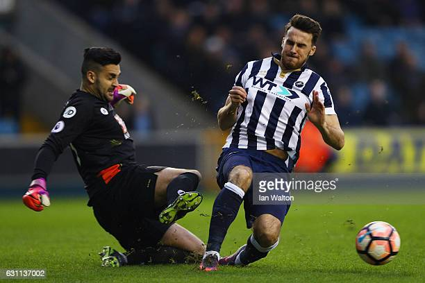 Adam Federici of AFC Bournemouth and Lee Gregory of Millwall compete for the ball during the Emirates FA Cup third round match between Millwall and...