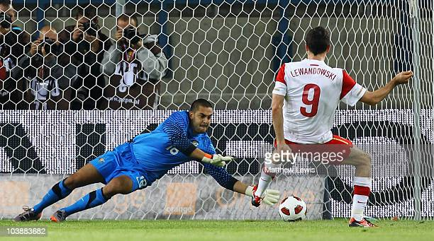 Adam Federici of Australia saves a penalty from Robert Lewandowski of Poland during the International Friendly match between Poland and Australia at...