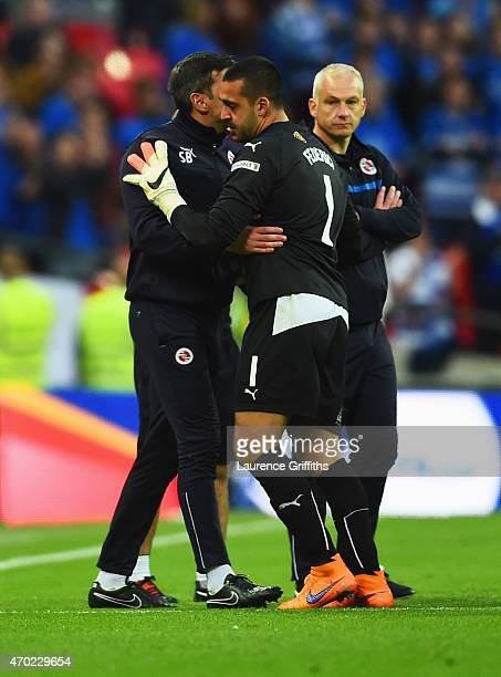 Adam Federici of Reading is consoled after the FA Cup Semi Final between Arsenal and Reading at Wembley Stadium on April 18 2015 in London England
