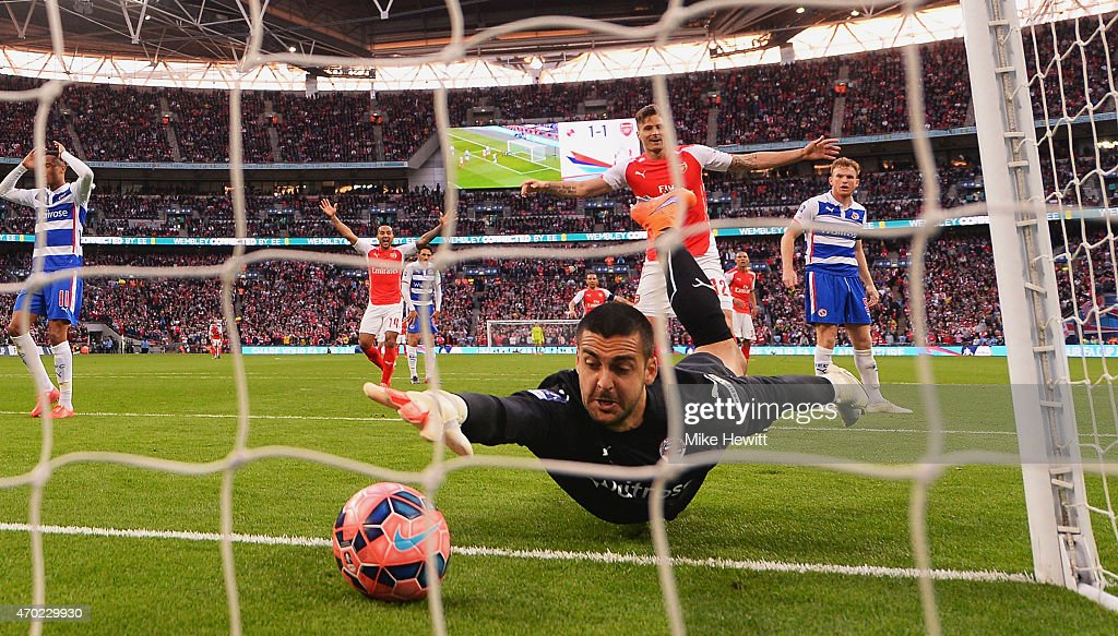 Adam Federici of Reading stretches for the ball as he fails to stop a shot by Alexis Sanchez of Arsenal for their second goal during the FA Cup Semi Final between Arsenal and Reading at Wembley Stadium on April 18, 2015 in London, England.