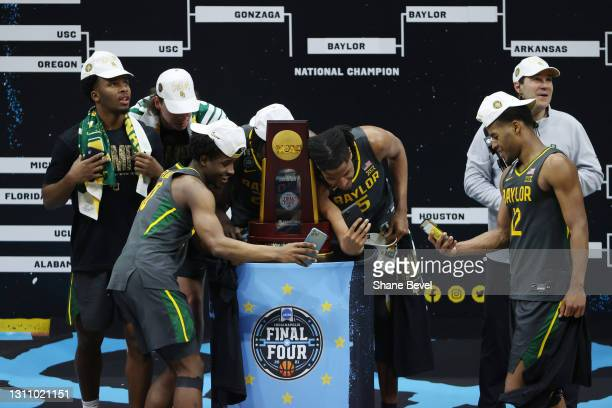 Adam Flagler and Jordan Turner of the Baylor Bears take selfies with the trophy after defeating the Gonzaga Bulldogs in the National Championship...