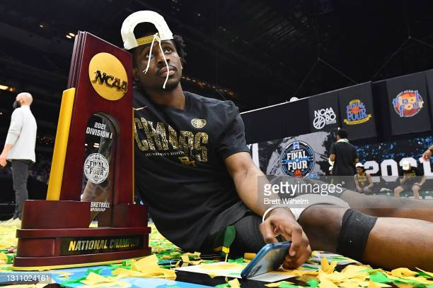Adam Flagler of the Baylor Bears celebrates with the trophy after defeating the Gonzaga Bulldogs in the National Championship game of the 2021 NCAA...