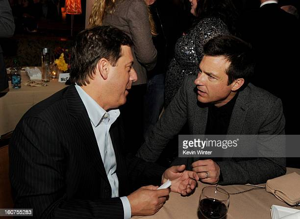 """Adam Fogelson , Chairman, Universal Pictures and actor Jason Bateman talk at the after party for the premiere of Universal Pictures' """"Identity Thief""""..."""