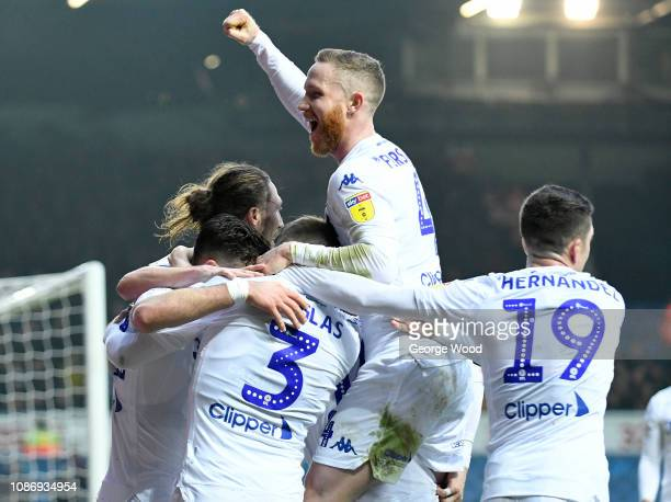 Adam Forshaw of Leeds United leads celebrations after the opening goal an own goal scored by Derrick Williams during the Sky Bet Championship match...