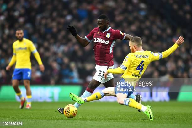 Adam Forshaw of Leeds United tackles Yannick Bolasie of Aston Villa during the Sky Bet Championship match between Aston Villa and Leeds United at...