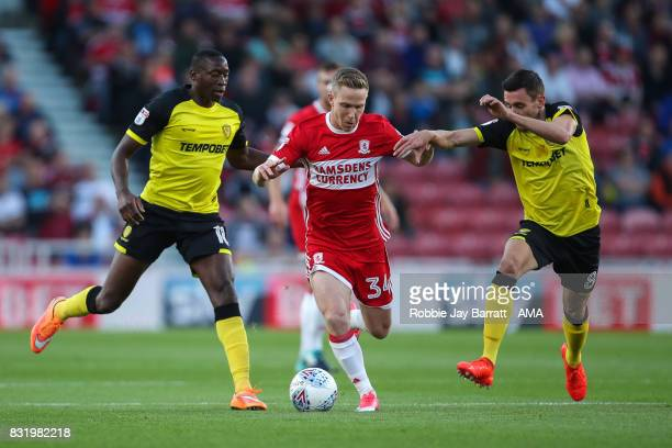 Adam Forshaw of Middlesbrough and Matthew Lund of Burton Albion during the Sky Bet Championship match between Middlesbrough and Burton Albion at...