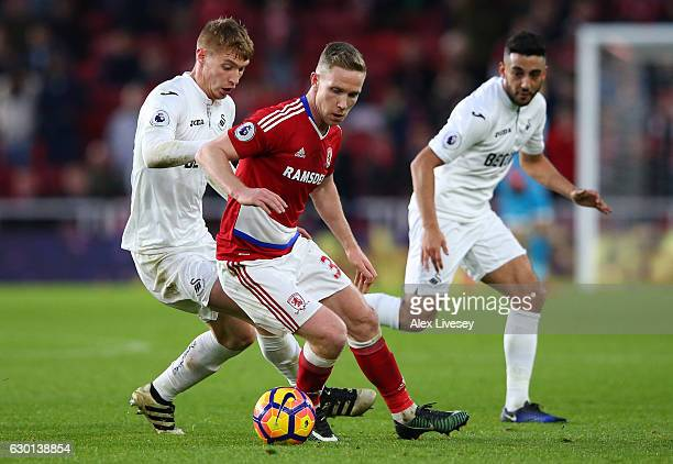 Adam Forshaw of Middlesbrough attempts to get away from Jay Fulton of Swansea City during the Premier League match between Middlesbrough and Swansea...