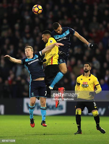 Adam Forshaw of Middlesbrough Etienne Capoue of Watford and Rudy Gestede of Middlesbrough battle to win a header during the Premier League match...