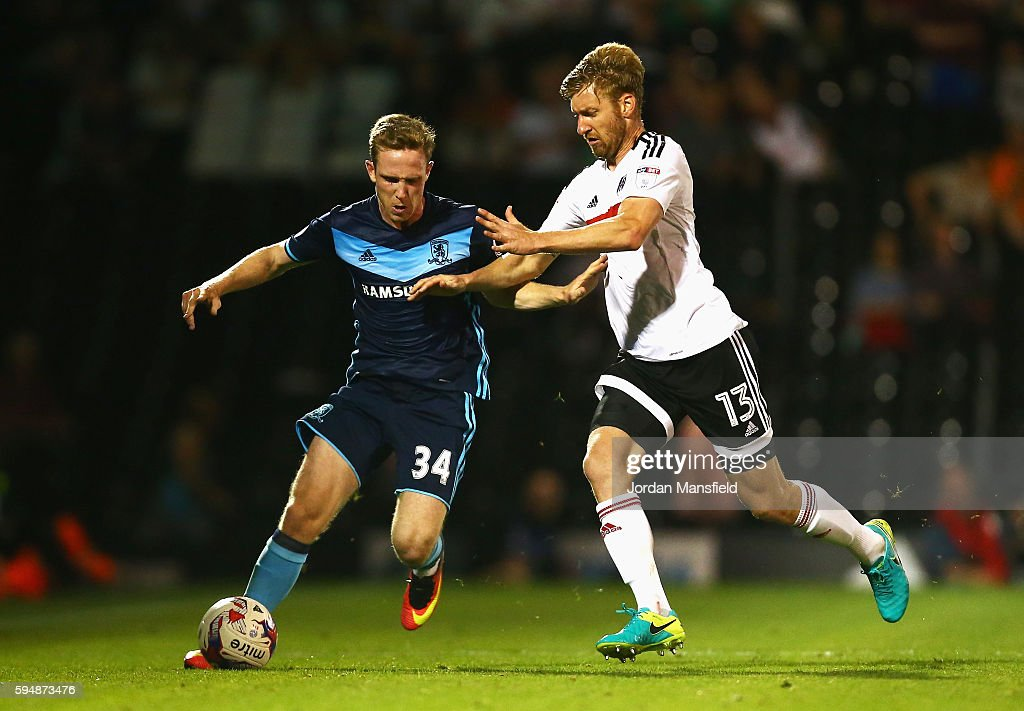 Adam Forshaw of Middlesbrough is challenged by Tim Ream of Fulham during the EFL Cup second round match between Fulham and Middlesbrough at Craven Cottage on August 24, 2016 in London, England.