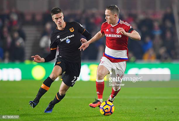 Adam Forshaw of Middlesbrough is chased by Markus Henriksen of Hull City during the Premier League match between Middlesbrough and Hull City at...