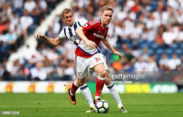 Adam Forshaw of Middlesbrough is closed down by Darren Fletcher of West Bromwich Albion during the Premier League match between West Bromwich Albion...