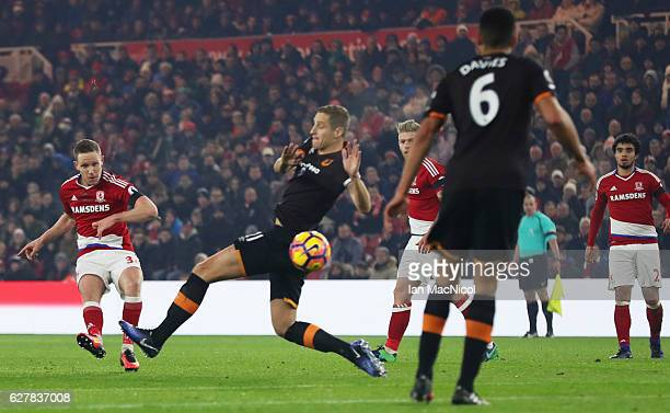 Adam Forshaw of Middlesbrough shoots past Michael Dawson of Hull City during the Premier League match between Middlesbrough and Hull City at...