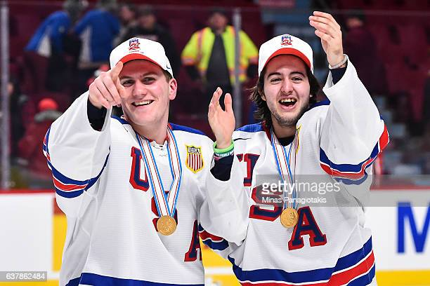 Adam Fox and teammate Jeremy Bracco of Team United States react as they win the gold medal round against Team Canada during the 2017 IIHF World...
