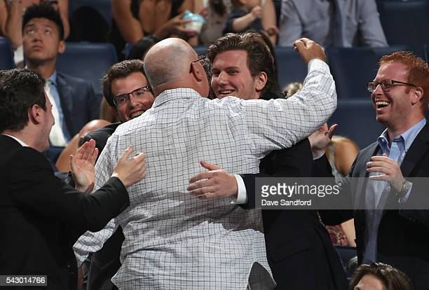 Adam Fox celebrates after being selected 66th overall by the Calgary Flames during the 2016 NHL Draft at First Niagara Center on June 25 2016 in...