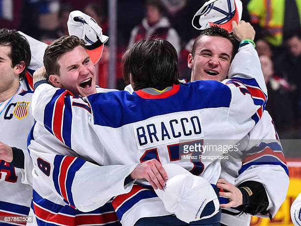 Adam Fox Jeremy Bracco and Tyler Parsons of Team United States celebrate as they win the gold medal round against Team Canada during the 2017 IIHF...