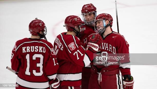 Adam Fox of the Harvard Crimson celebrates his goal against the Boston University Terriers with his teammates Nathan Krusko Frédéric Grégoire and...