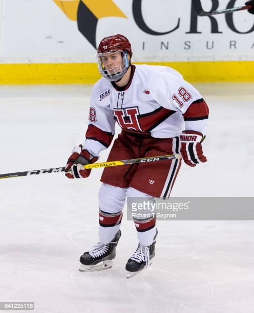 Adam Fox of the Harvard Crimson skates during NCAA hockey against the Northeastern Huskies in the semifinals of the annual Beanpot Hockey Tournament...