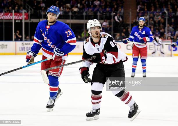 Adam Fox of the New York Rangers and Conor Garland of the Arizona Coyotes react during the second period of their game at Madison Square Garden on...