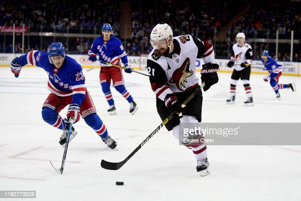 Adam Fox of the New York Rangers chases Derek Stepan of the Arizona Coyotes as he controls the puck during the third period of their game at Madison...