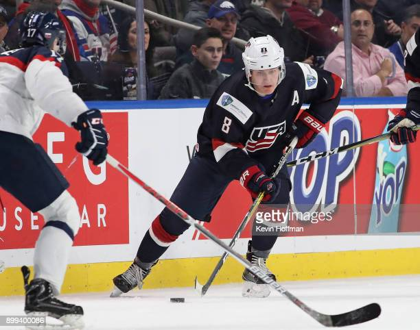 Adam Fox of United States skates up ice with the puck in the first period against Slovakia during the IIHF World Junior Championship at KeyBank...