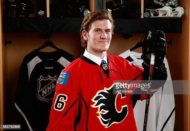 Adam Fox poses for a portrait after being selected 66th overall by the Calgary Flames during the 2016 NHL Draft at First Niagara Center on June 25...