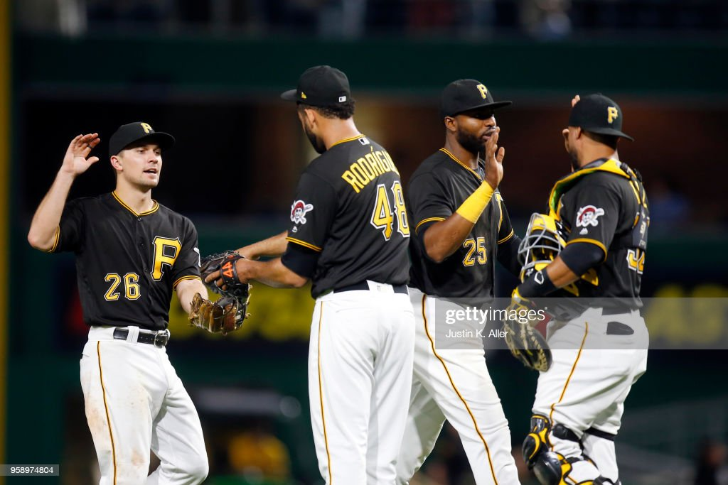 Adam Frazier #26 and Gregory Polanco #25 of the Pittsburgh Pirates celebrate after defeating the Chicago White Sox 7-0 during inter-league play at PNC Park on May 15, 2018 in Pittsburgh, Pennsylvania.