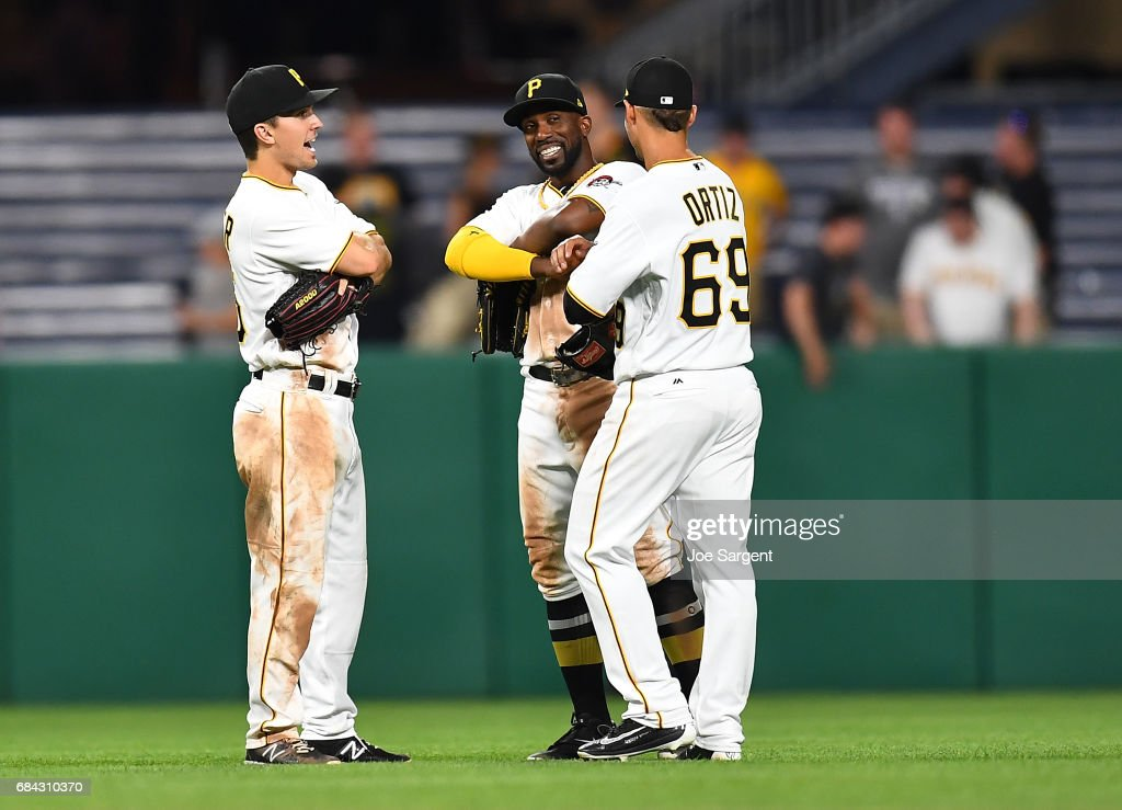 Adam Frazier #26, Andrew McCutchen #22 and Danny Ortiz #69 of the Pittsburgh Pirates celebrate after a 6-1 win against the Washington Nationals at PNC Park on May 17, 2017 in Pittsburgh, Pennsylvania.