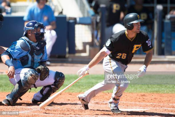 Adam Frazier of the Pittsburgh Pirates bats during a spring training game against the Tampa Bay Rays at Charlotte Sports Park on March 20 2017 in...