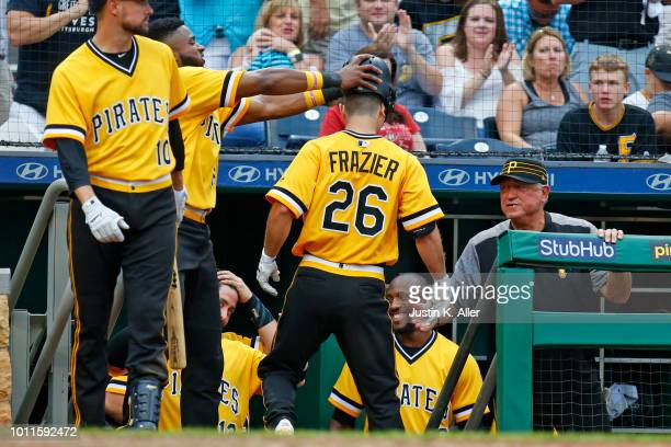 Adam Frazier of the Pittsburgh Pirates celebrates with Gregory Polanco and manager Clint Hurdle after hitting a home run in the seventh inning...