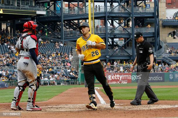 Adam Frazier of the Pittsburgh Pirates crosses home after hitting a home run in the seventh inning against the St Louis Cardinals at PNC Park on...