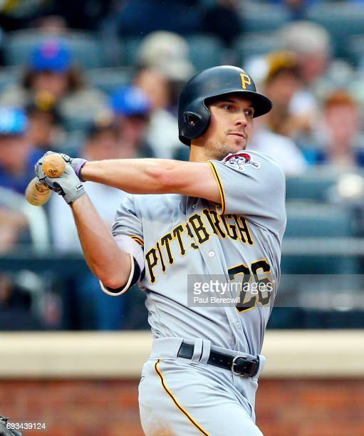 Adam Frazier of the Pittsburgh Pirates follows through in an MLB baseball game against the New York Mets on June 4 2017 at CitiField in the Queens...